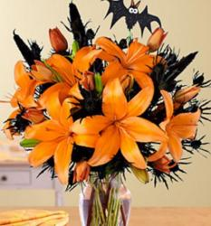 Halloween flower arrangement with orange lilies and black flowers and bats flower decor.JPG