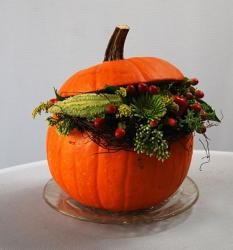 Halloween flower arrangements with fresh pumpkin and fresh flowers.JPG