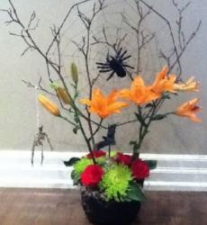 Halloween spider planter with colorful fresh flowers with large black spider.JPG