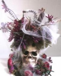 Skull centerpiece with fresh flowers and spider web perfect for halloween.JPG