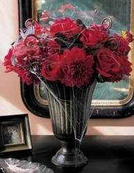 2015 flower vase with red flowers and spider webs and small black spiders.JPG