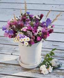 Purple wedding flowers theme with wild flowers in combonation of purple, pink, blue and white flowers.JPG
