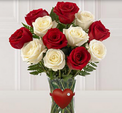 Cute valentines day bouquet with white roses and red roses with glass vase