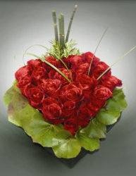 Heart shape valentines flowers centerpiece with red roses and leaves very unique valentines gift
