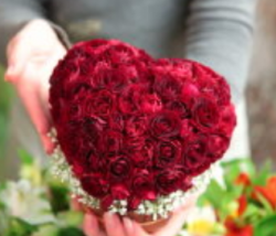 Valentines flowers bouquet looks like a heart with beautiful red roses
