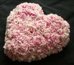 Valentines heart shape flowers arrangement with pink flowers
