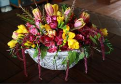 Beautiful Easter flowers arrangement with fresh spring flowers