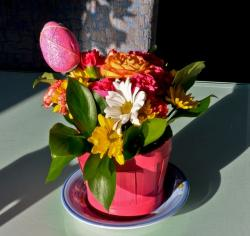 Cute Easter flowers gift with fresh bright colored flowers with easter egg