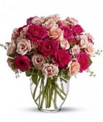 Fancy mother's day centerpiece with beautiful roses in hot pink and pinkish peach roses