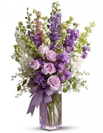 Purple flowers centerpiece perfect for mother's day