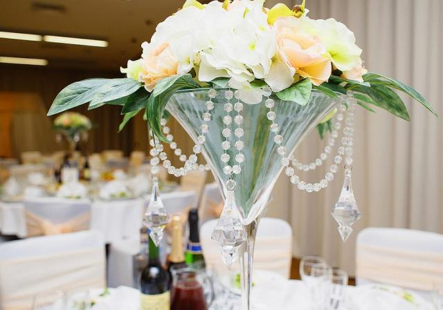 Wedding centerpiece in in gaint coctail glass with pearls