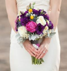 Beautiful summer bridal bouquet with flowers in bright colors