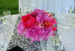 Summer wedding arrangment with hot pink flowers