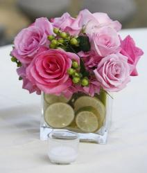 Square wedding centerpiece with pink roses and lime slides in the vase