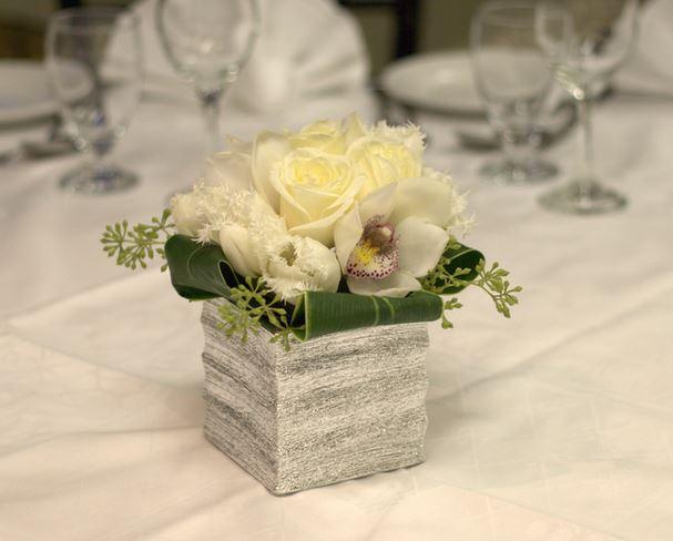 Unique Wedding Centerpiece With White Flowers In Rock Vase