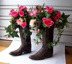Cowboy theme wedding centerpieces in cowboy boots