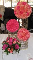 Modern wedding arrangements with tall glass vases and pink flowers