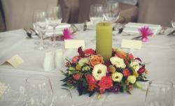 wedding flowers and candle arangement
