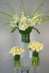 Green and white wedding flowers arrangements in tall vases