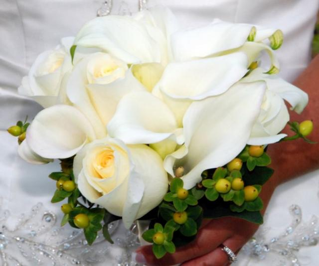 Classy wedding bouquet with white roses and lilies