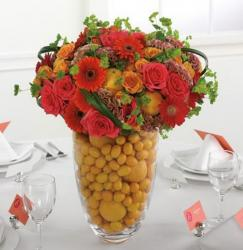 equnie wedding centerpiece with orage flowers