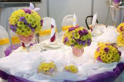 Pretty wedding table setting with bright flowers