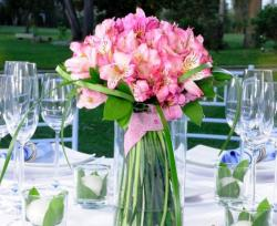 Beautiful wedding centerpieces with pink flowers in tall glass vase