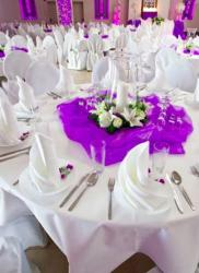 Purple and white wedding table decor with white flowers