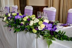 Purple wedding flowers with large centerpiece
