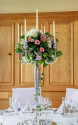 Tall wedding centerpiece with candles