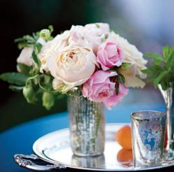 Beautiful wedding flowers with shinny vase on mirror tray