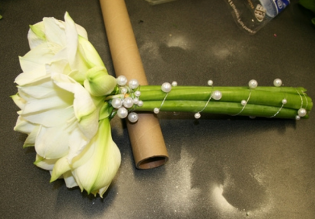 Modern wedding bouquet with a single white flowerg mightylinksfo