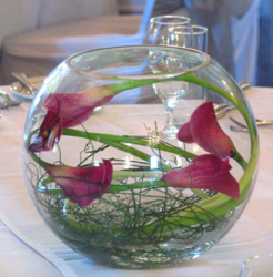 Unique centerpiece with purple lilies in a fish ball.PNG