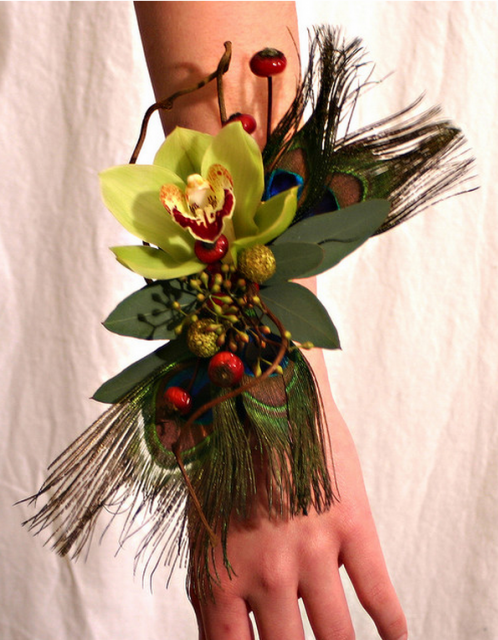 Peacock corsage for weddings.PNG
