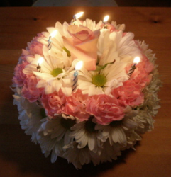 Fresh birthday cake in pink with candels.PNG