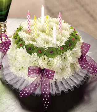 Fresh flower cake shaped flower arrangement.PNG