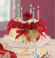 LIght yellow, white and red flowers with birthday cake shape with candles.PNG