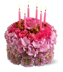 Pink fresh flowers cake shape with pink candels.PNG