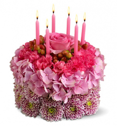 Three tones pink fresh flowers bithday cakes with pink candles.PNG