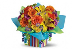 Colorful flowers bouquet in colorful square gift box.PNG