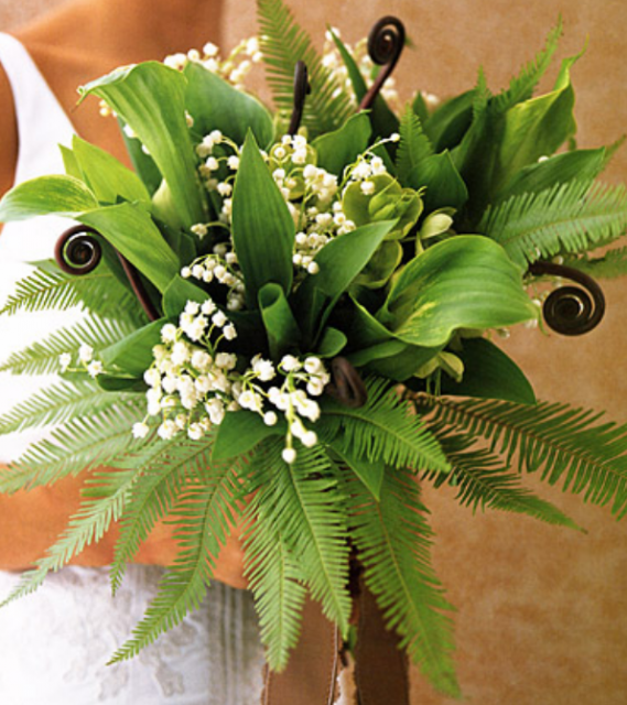 Green wedding bouquet with small white flowers.PNG