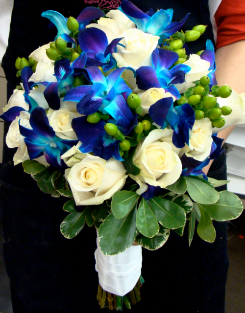 Blue flowers wedding bouquet with blue orchids and white roses and green leaves.PNG