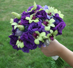 Dark purple flowers weddingbouquet with green flowers.PNG