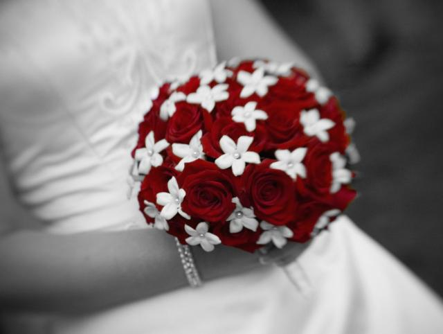 Red wedding bouquet of flowers