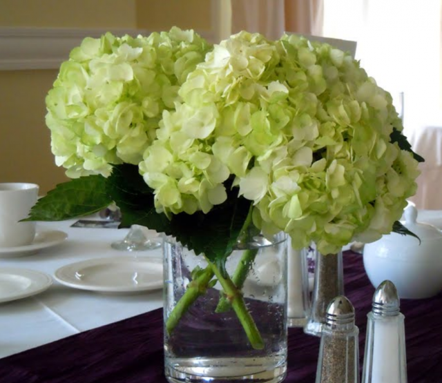 Green center pieces with big flowers.PNG