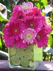 Pink flowers center piece with lemons in the vase water.PNG