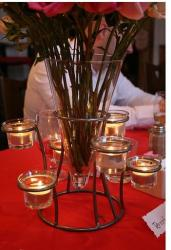 candles wedding table center piece with flowers.jpg