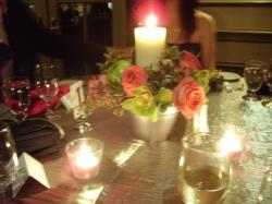 center pieces for wedding reception with roses and candles.jpg