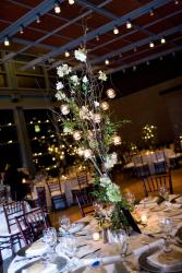 wedding center pieces with with white flowers and candles.jpg