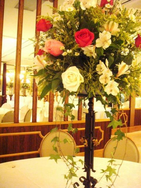 Floral wedding center pieces for tables picture.jpg